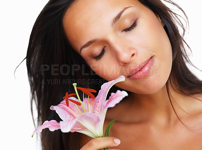 Buy stock photo Head shot of pretty woman holding a flower with eyes closed
