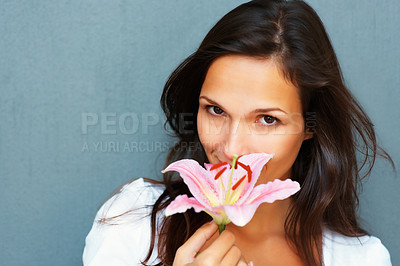 Buy stock photo Head shot of pretty woman holding a flower outward