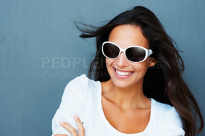 Buy stock photo Pretty woman with arms folded wearing sunglasses