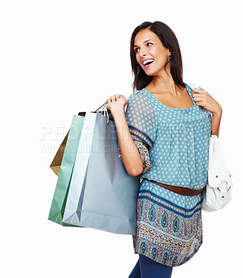 Buy stock photo View of woman looking behind her while carrying shopping bags