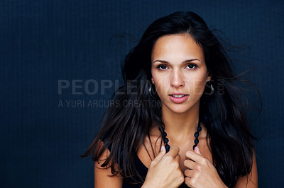 Buy stock photo Head shot of woman holding onto beads in a sensual manner