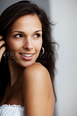 Buy stock photo Closeup portrait of a cute young female model looking away in thought