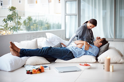 Buy stock photo Portrait of a sweet young couple enjoying themselves at home - Indoor