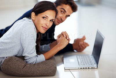 Buy stock photo Portrait of a beautiful young woman working on laptop with her boyfriend