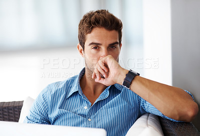 Buy stock photo Portrait of a young man using a laptop on a sofa at home
