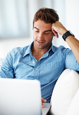 Buy stock photo Shot of a smart young man working on laptop at home - Indoor