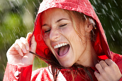 Buy stock photo Portrait of excited teenage girl enjoying rain outdoors