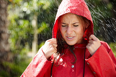 Buy stock photo Portrait of cute teeange girl in red raincoat standing outside in rain