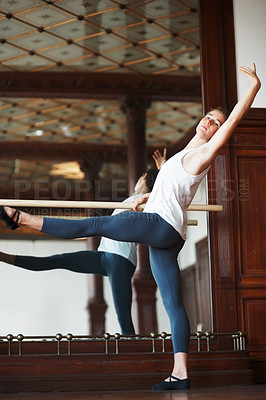Buy stock photo Portrait of a young male ballet dancer practicing against mirror