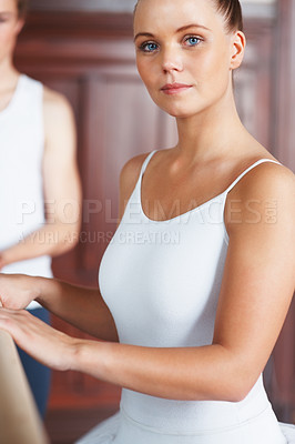 Buy stock photo Portrait of a beautiful female dancer with trainer in background