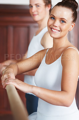 Buy stock photo Portrait of a happy female dancer with partner in the background