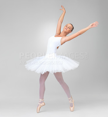 Buy stock photo Full length of a cute ballerina dancing gracefully against white background - copyspace
