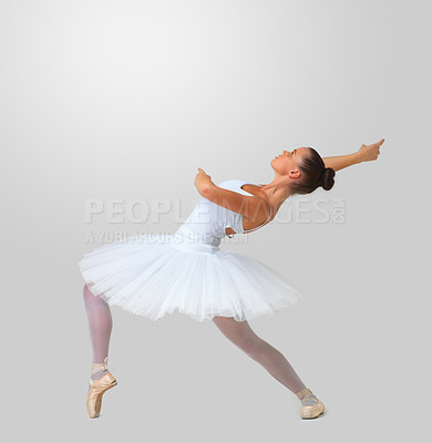 Buy stock photo Full length of a beautiful young dancer dancing against white background