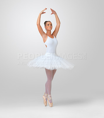 Buy stock photo Full length of a pretty young ballerina dancing against white background - copyspace