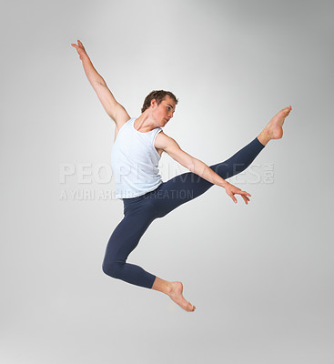 Buy stock photo Full length of a male ballet dancer performing against white background - copyspace