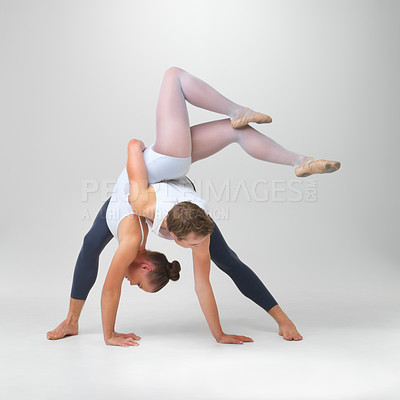 Buy stock photo Full length of two ballet dancers performing against white background - copyspace