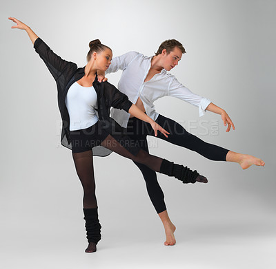 Buy stock photo Full length of two modern ballet dancers performing against white background
