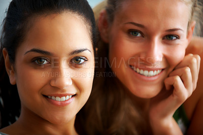 Buy stock photo Closeup portrait of pretty young female friends smiling together