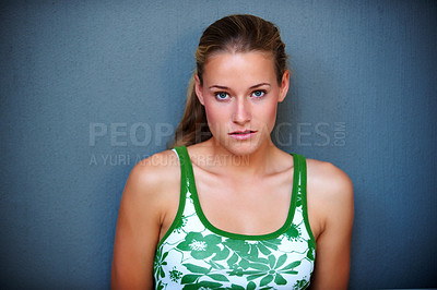 Buy stock photo Portrait of cute teenager looking at you against grey background
