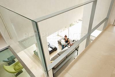 Buy stock photo Top view of a woman reading a book in modern spacious living room with glass walls
