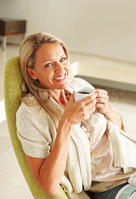 Buy stock photo Closeup portrait of a cheerful mature woman drinking coffee