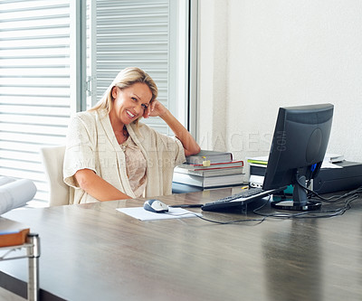 Buy stock photo Portrait of a cheerful casual executive sitting at her work desk