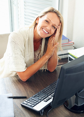 Buy stock photo Portrait of a cute mature business woman smiling at her work desk