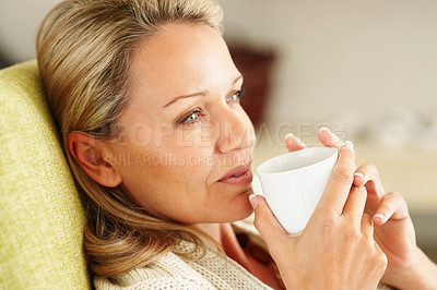 Buy stock photo Detail shot of a thoughtful beautiful middle aged woman with a tea cup