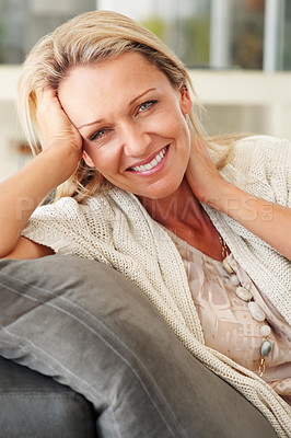 Buy stock photo Closeup portrait of a pretty middle aged woman giving you a warm smile