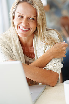 Buy stock photo Closeup portrait of a beautiful middle aged female with a laptop at desk