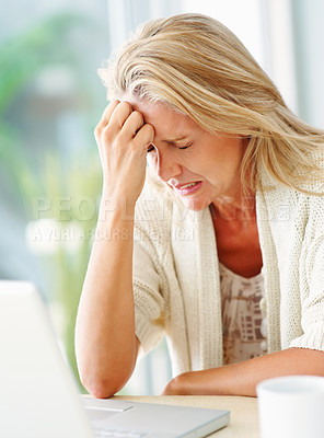 Buy stock photo Caucasian mid adult woman with worried expressing in front of laptop