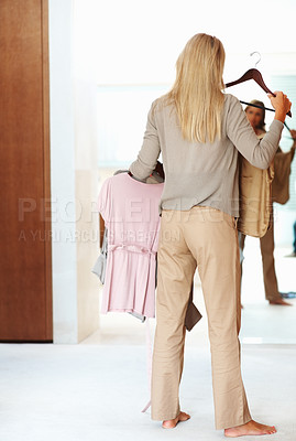 Buy stock photo Rear view of a mature woman trying clothes in front of a mirror