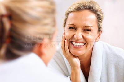 Buy stock photo Closeup portrait of a happy mature woman looking at herself and smiling