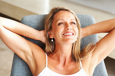 Buy stock photo Closeup portrait of a relaxed mature woman smiling over a thought