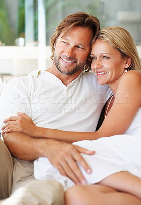 Buy stock photo Portrait of a relaxed mature man and woman looking at something interesting