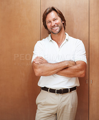 Buy stock photo Portrait of a happy friendly mature man smiling with hand folded