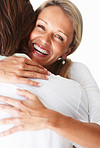 Closeup of a cheerful mature woman hugging a man