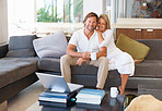 Mature couple sitting together comfortable at home