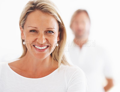 Buy stock photo Closeup portrait of a pretty mature woman smiling with man in the background