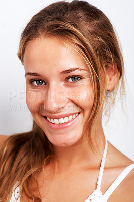 Buy stock photo Closeup portrait of happy teenage girl smiling against white background