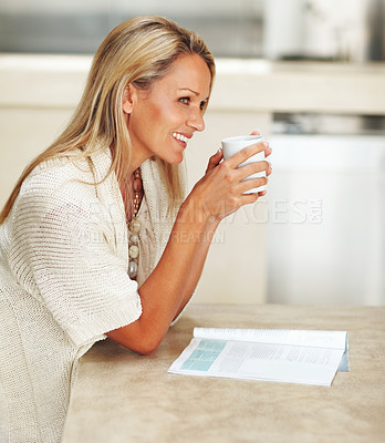 Buy stock photo Side view portrait of a mature woman smiling over a thought while drinking tea
