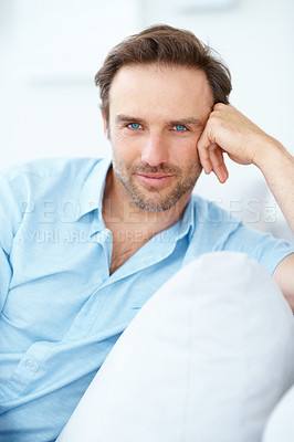 Buy stock photo Closeup portrait of a handsome young man sitting on sofa - Indoor