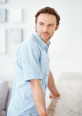 Buy stock photo Portrait of a handsome young male looking away at home - Indoor
