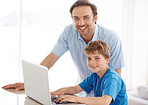 Cute little boy and his dad with a laptop