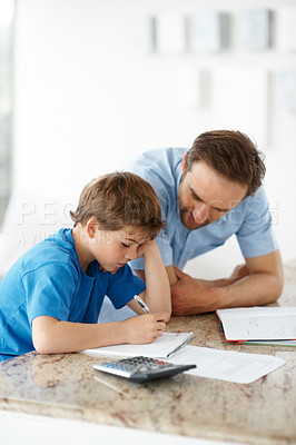 Buy stock photo Portrait of a young father assisting to his son with homework - Indoor