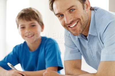 Buy stock photo Portrait of a happy young man with his cute son - Indoor