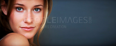 Buy stock photo Closeup portrait of smart young female model posing confidently against grey background - Copyspace