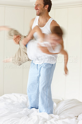Buy stock photo Portrait of a happy young male playing with a small boy