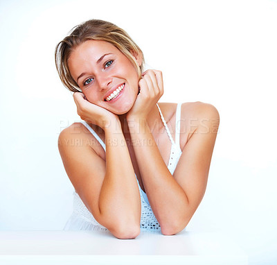 Buy stock photo Portrait of a happy young woman with her hand on cheeks against white background