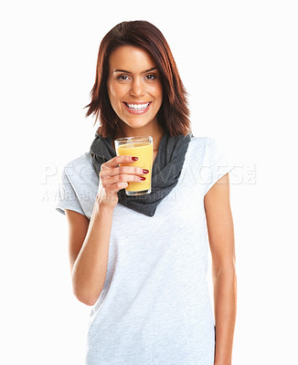 Buy stock photo Portrait of a beautiful young woman with a glass of orange juice isolated over white background